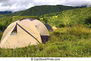 Range of tents in the mountains - Range of tents in the...