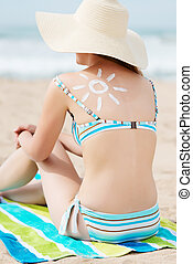 Bikini Woman In Sunhat With Sun Drawn On Back At Beach -...