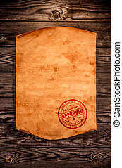 Blank old paper against the background of an aged wood -...