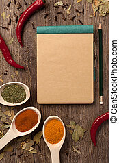 peppers, spices in spoons, notebook and pencil - Red chili...