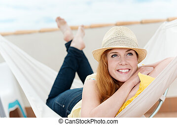Happy Relaxed Woman Daydreaming In Hammock - Happy and...