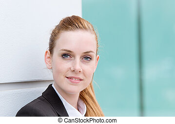Portrait Of Young Happy Businesswoman - Closeup of a happy...
