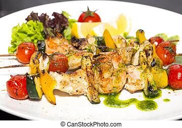 skewers of seafood grilling