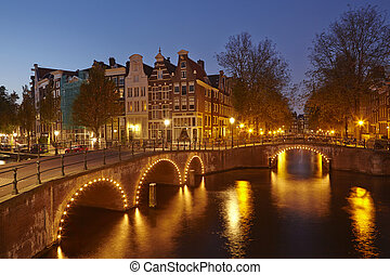 Amsterdam, Netherlands - Houses at a canal in the blue hour...