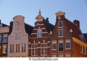 Amsterdam, Netherlands - Gables in the evening - Gables of...