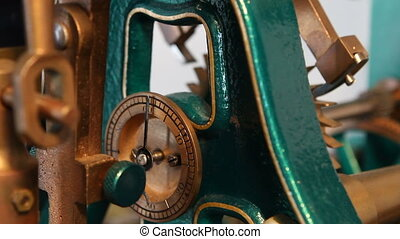 Antique Clockworks - Gears, dials and levers move on the...