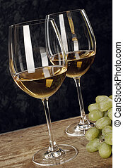 white wine - two glasses of white wine with grapes