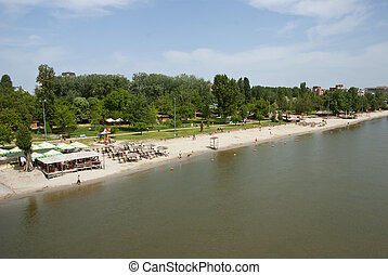 River beach in Novi Sad, Serbia - People sunbathing at the...