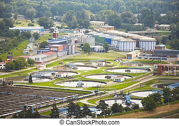 Waste water treatment plant - groups of storage tanks with...