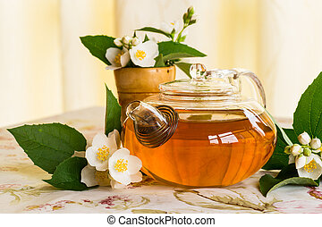 fragrant jasmine tea in the teapot on the table