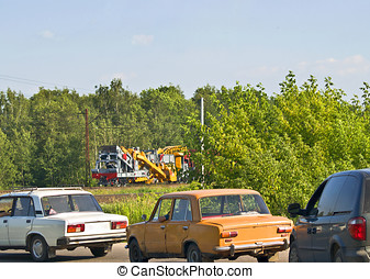 old cars - russian oldtimers near railroad