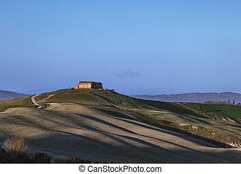 Tuscany, Crete Senesi old farmland and rolling hills on sunset. Rural landscape, Italy, Europe.