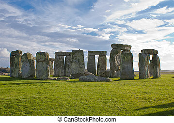 Stonehenge under a blue and cloudy sky - Stonehenge is a...