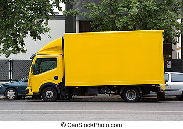 Delivery Truck - A yellow deliver truck in the street.