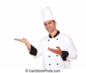Male chef standing with palms open - Portrait of a male chef...