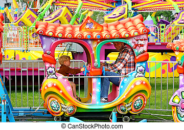 Father Son on Carnival Train Ride - Father and Son on...