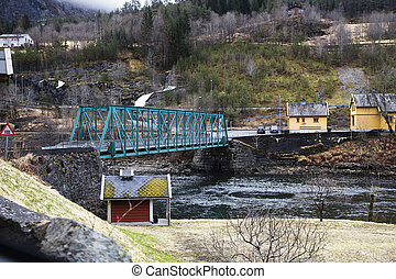 Truss bridge with a ride on the bottom of a Norwegian fjord