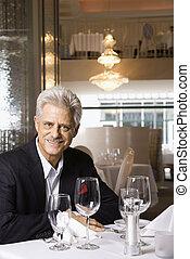 Mature man in restaurant. - Caucasian mature adult male...