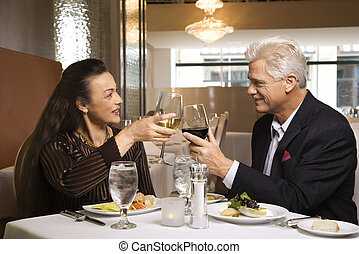 Couple on dinner date - Caucasian mature adult male and...