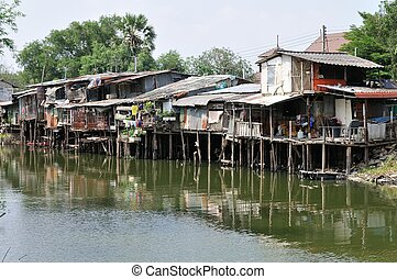 Slum on dirty canal in Thailand - Slum on dirty canal in...