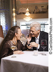 Mature man proposing to woman - Caucasian mature adult male...