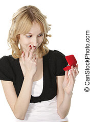 Unexpected gift - Pretty blonde young woman looking at ring...