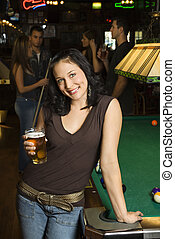 Woman drinking beer. - Portrait of young caucasian woman...