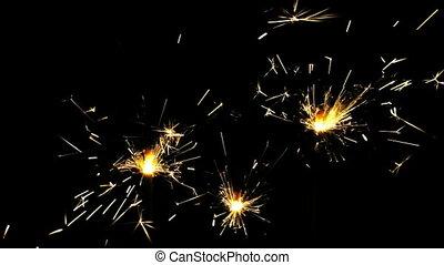Sparklers over black