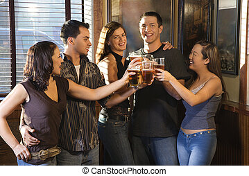 Group drinking beer - Group of young friends hanging out in...