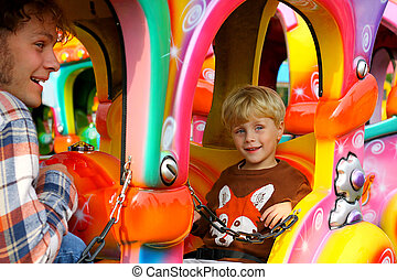 Father and Son on Carnival Ride - Father and Son on a...