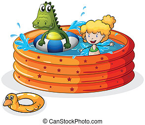 A girl and a crocodile swimming inside the inflatable pool -...