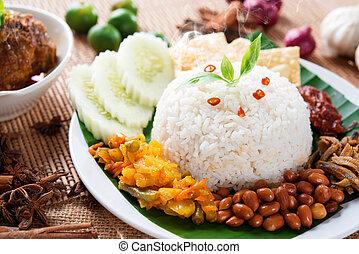 Nasi lemak kukus traditional malaysian spicy rice dish,...