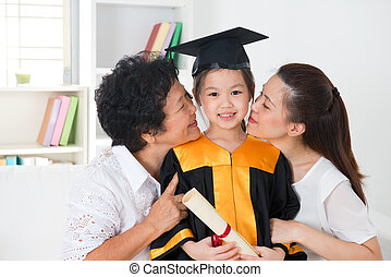 Kindergarten graduation. Asian family, grandparent and...