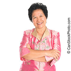 Asian senior woman. Happy smiling Asian grandparent standing...