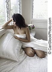 beautiful woman in her boudoir
