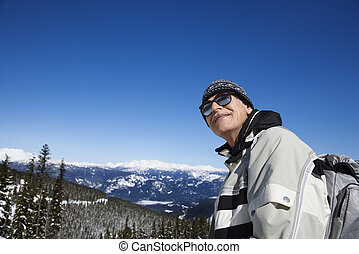 Man skier in mountains.