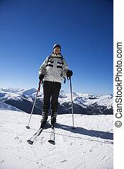 Man on ski slopes - Caucasian senior man skier on slopes