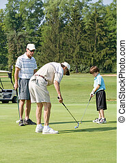Family Playing Golf - Grandpa Enjoying Golf With Son and...