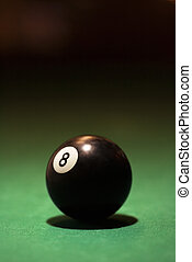 Billiards eight ball. - Eight ball on green billiards table.