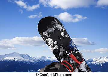 Snowboard and mountain.