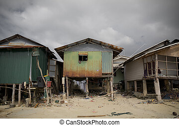 Poor fishers houses along sea coast, Koh Samui, Thailand