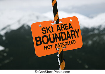 Ski trail boundary sign. - Ski area trail boundary sign.
