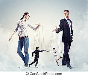 Businesspeople with marionettes - Image of man and woman...