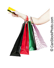A woman buys a credit card - Credit cards and shopping bags...
