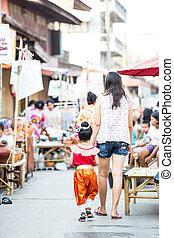 tourists at Rim Yom 2437 night market Sukhothai - SUKHOTHAI,...