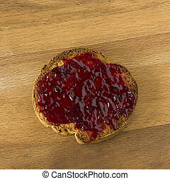 marmelade on a slice of bread biscuit
