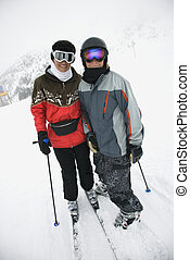 Mom and son at ski slope. - Middle-aged mother with teenage...