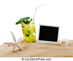 Mojito cocktail on the sandy beach with blurred sea