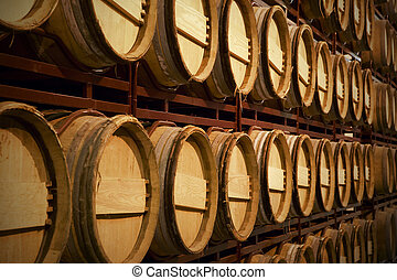 Wine barrels in an aging process at spanish cellar
