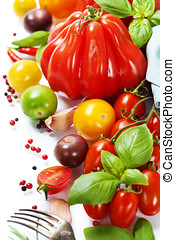 fresh tomatoes and herbs - healthy eating concept - Assorted...